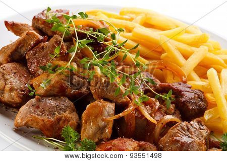Kebab, chips and vegetables