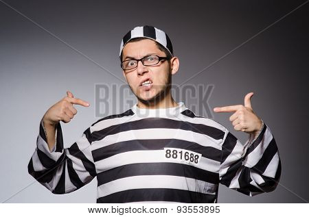 Funny prisoner isolated on gray