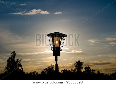 The sun shines through a lantern