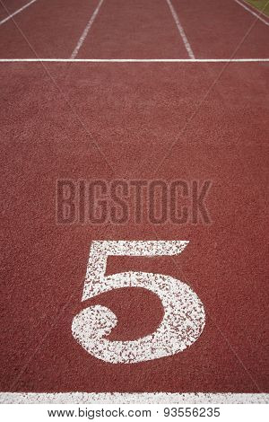 Number Five Signpost In A Athletic Running Track