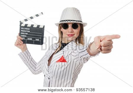 Beautiful girl in striped clothing holding clapperboard isolated on white