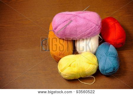 Colorful Skeins Of Yarn On A Wooden Table