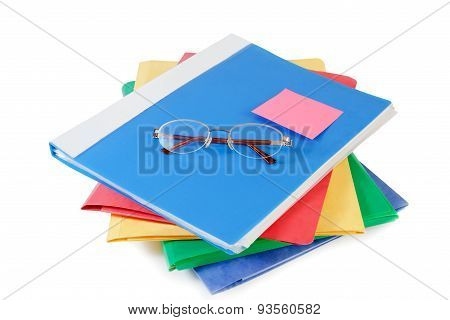 Multicolored Folders With Glasses On White Background