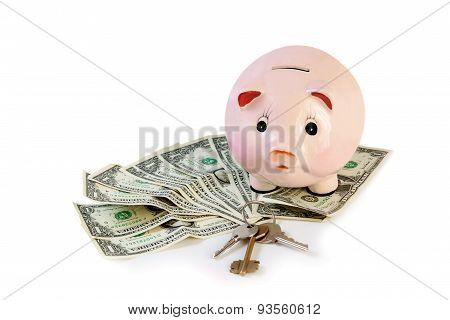 Piggy Bank With House Keys  And Money Isolated On White
