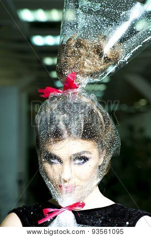 Womans Head In Cellophane