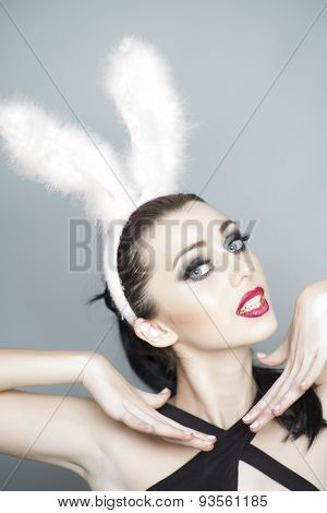 Playful Woman In Bunny Ears