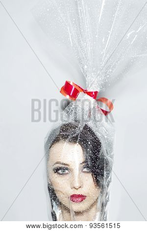Head Of Pretty Woman In Cellophane