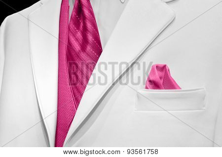 white wedding tuxedo and pink tie