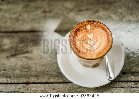 Art Latte Coffee With Leaf Pattern On Wooden Background