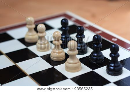 Battle of pawns on the chessboard