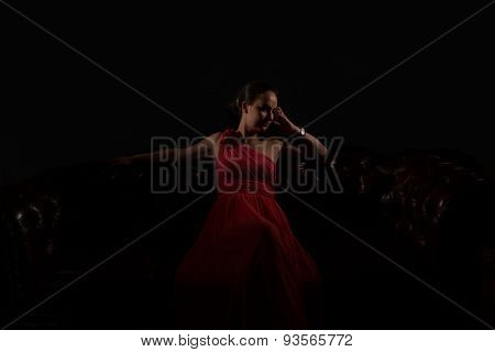 Lady In Red In A Dark Room.
