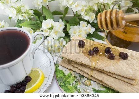 Healthy Breakfast With Honey And Chokeberry Tea