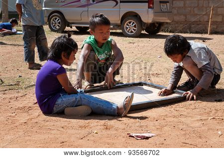 Indian Children Playing On The Street In Bangalore