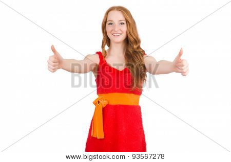 Young beautiful girl in red dress thums up isolated on white