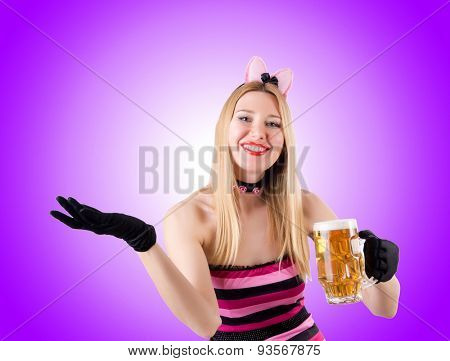 Woman with beer against the gradient