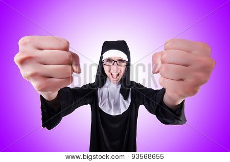 Funny nun against the colourful gradient