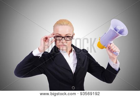 Woman businesswoman with loudspeaker against the gradient