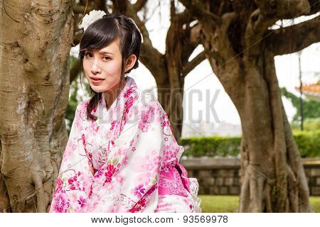 Asian Woman In Kimono In Garden