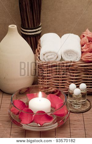 Spa and Aromatheraphy treatment Bowl with candle and rose petals