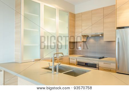 Fragment of modern kitchen with stainless steel appliances in a luxury apartment.