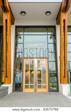 Entrance of a house building with wood trim.