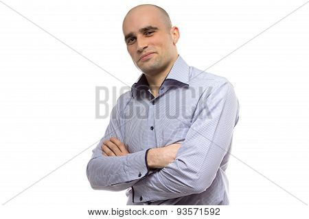 Photo of grinning hairless business man