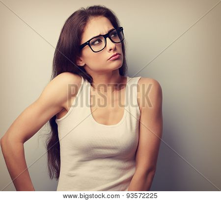 Anger Young Casual Woman In Glasses Thinking And Looking Up. Vintage Portrait