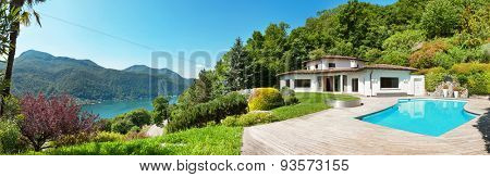 Architecture, beautiful villa with swimming pool, panorama