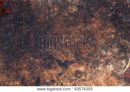 Dark wooden surface with scratches