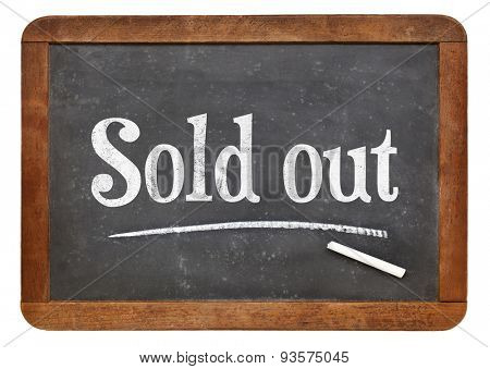 Sold out sign  - white chalk text on an isolated  vintage slate blackboard