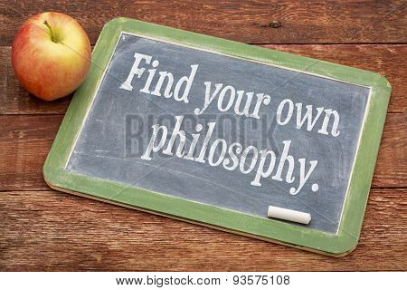 Find your own philosophy - motivational words on a slate blackboard against red barn wood