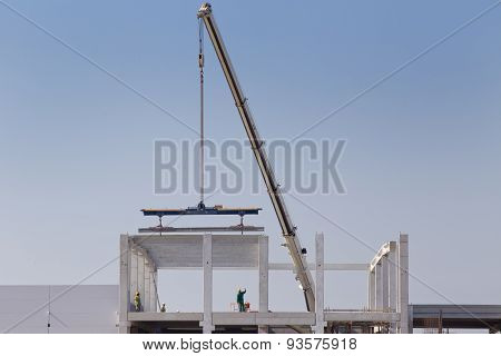 Crane Lifting Concrete Beam