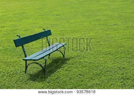 Lonely bench on short cut grass