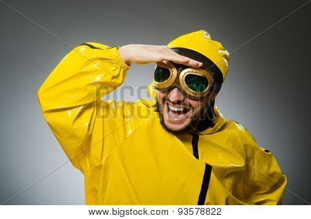 Man wearing yellow suit and aviator glasses