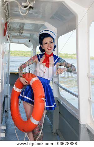 Pin-up girl sailor on the ship