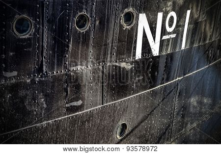 Photo Of A Number One Sign On A Grungy Ship Side.