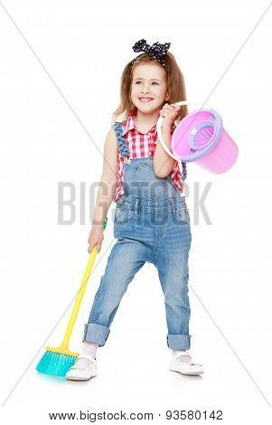 Funny little girl in denim overalls