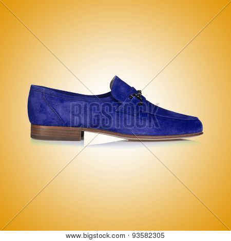 Fashion concept with male shoes against gradient