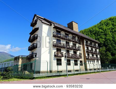 Multi-storey Building On A Background Of A Hill