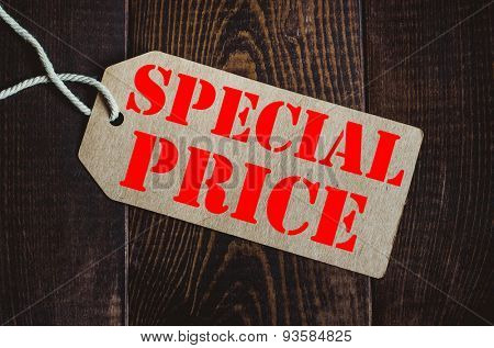 Special price. Blank tag on dark wood background