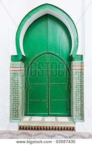 Green islamic wooden door.