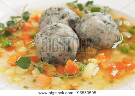 Clear vegetable soup or broth with bread dumplings