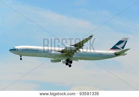 HONG KONG - JUNE 04, 2015: Cathay Pacific aircraft landing. Cathay Pacific is the flag carrier airline of Hong Kong, with its head office and main hub located at Hong Kong International Airport