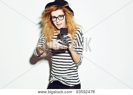 Woman photographer holding film camera on white background, Hipster style