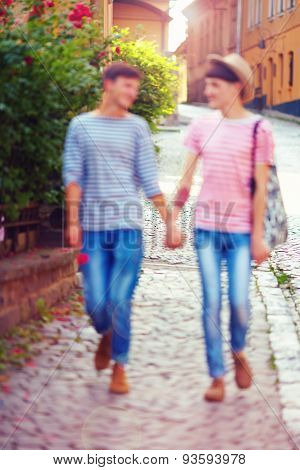 Happy Male Couple Walking The City Street, Defocused