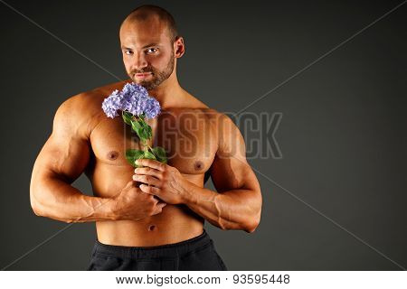 Muscular man with flower