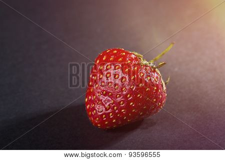 Single Strawberry With Black Background