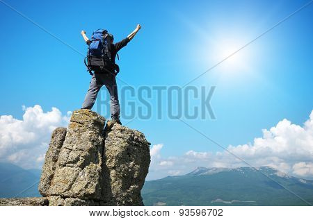 Man on peak of mountain. Emotional scene.
