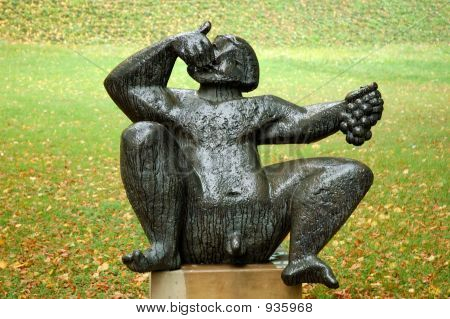 Statue Of A Boy Eating Grapes