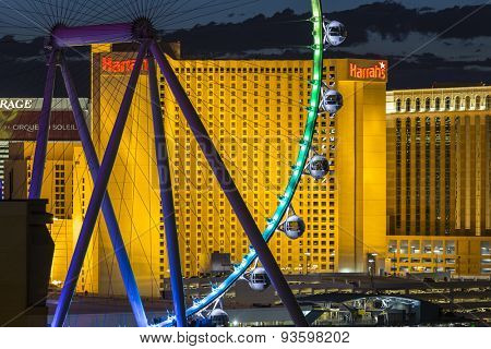 LAS VEGAS, NEVADA, USA - June 10, 2015:  Colorful lights on resort casino towers and High Roller ferris wheel on the Las Vegas strip.